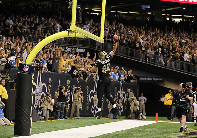 Jimmy Graham (6-foot-6) capped a three-yard touchdown catch with the signature celebration for basketball players-turned-tight ends.
