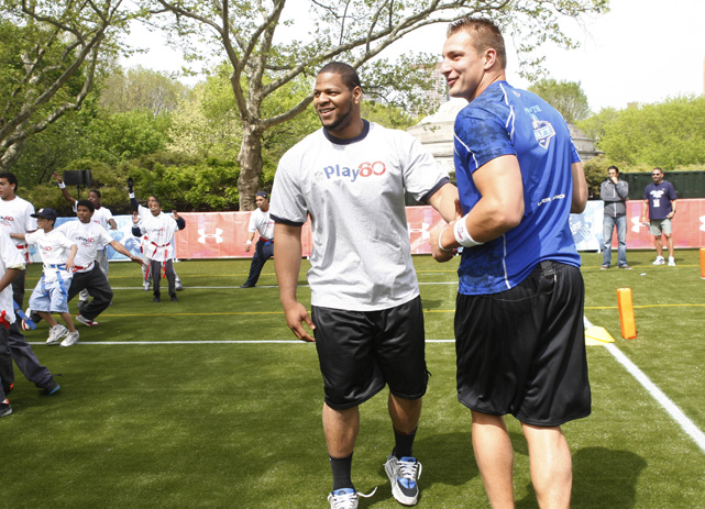 Despite missing his junior season with a back injury, Gronkowski declared himself eligible for the 2010 NFL Draft. Here he jokes around with Ndamukong Suh during a youth football clinic days before the draft.