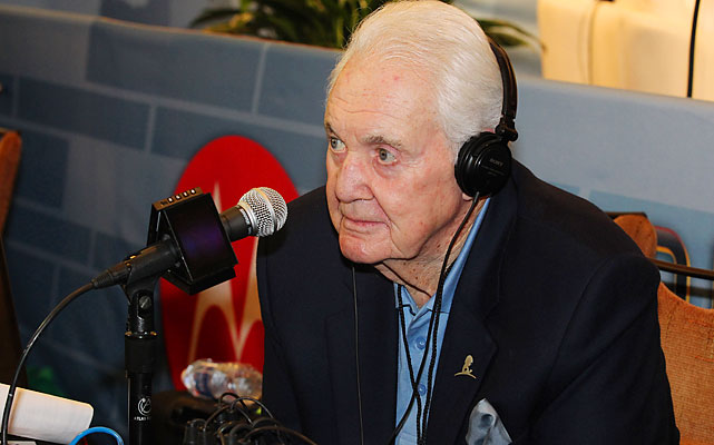 Long-time NFL voice Pat Summerall does interviews in the media center.