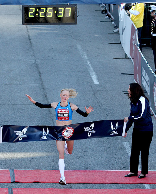 Colorado native Shalane Flanagan crosses the finish line to win the women's competition in an event-record time of 2:25.38.  Flanagan won a bronze in the 10,000-meter event in Beijing in 2008, but this was only her second career marathon.