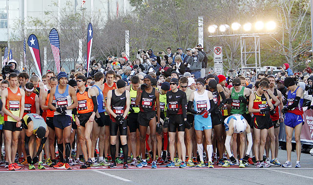 Competitors vying for a spot in the 2012 Olympics line up at the starting line prior to the men's U.S. Olympic marathon trials in Houston, Texas on Jan. 14.