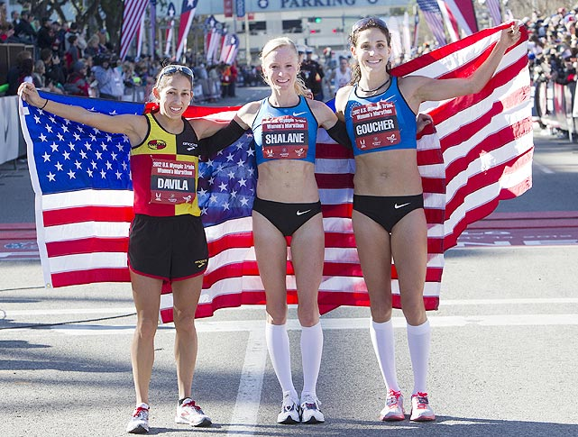 Desiree Davila (left), Shalane Flanagan (center) and Kara Goucher pose with the American flag after all three qualified for the 2012 Games.