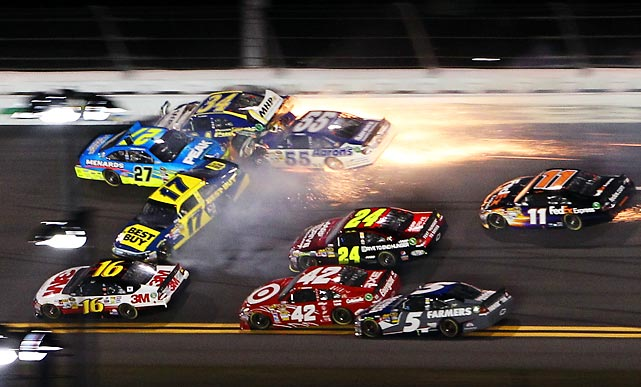 Paul Menard (No. 27), David Ragan (No. 34), Michael Waltrip (No. 55) and Matt Kenseth (No. 17) crash during the Budweiser Shootout at Daytona.