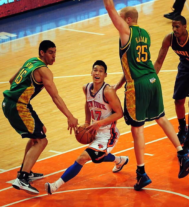 Knicks sensation Jeremy Lin drives to the basket against several New Orleans Hornets.
