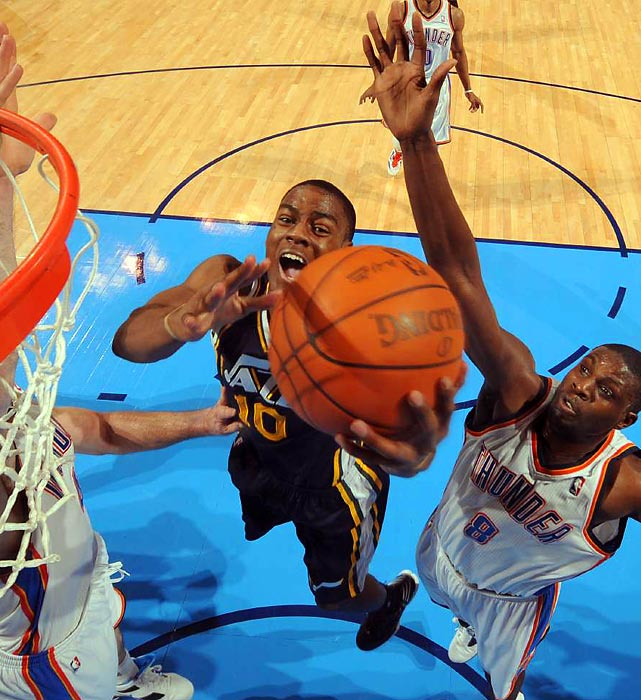 Utah guard Alec Burks puts up a layup in a game against the Oklahoma City Thunder.