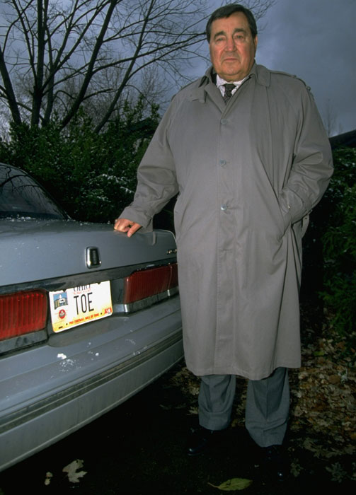 "Former Browns kicker Lou ""The Toe"" Groza poses next to his car."