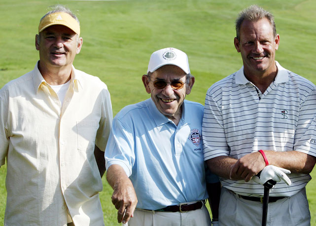 Murray poses with Baseball Hall of Famers Yogi Berra and George Brett at the annual Hall of Fame induction ceremony golf tournament in Cooperstown, NY.