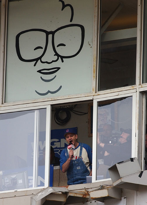 Murray sings  Take Me Out to the Ball Game  during the seventh inning stretch at the Cubs' 2004 home opener.