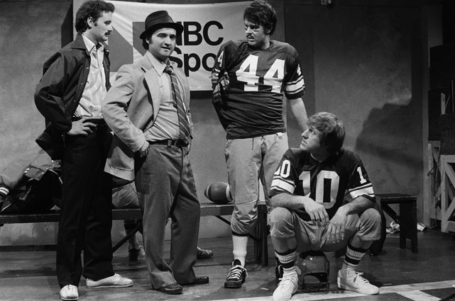 "Murray, fellow SNL players John Belushi and Dan Aykroyd and Minnesota Vikings quarterback Fran Tarkenton during the show's ""Team Saturday Night"" skit in 1977."