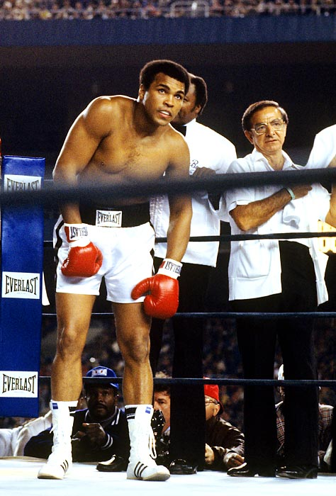 Dundee stands in Ali's corner during a 1976 fight against Ken Norton at Yankee Stadium. Dundee attended Ali's 70th birthday party in Louisville in January 2012.