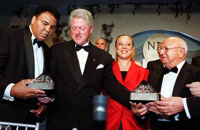 President Bill Clinton presents Dundee and Ali with the National Italian American Foundation's One America award in 2000.