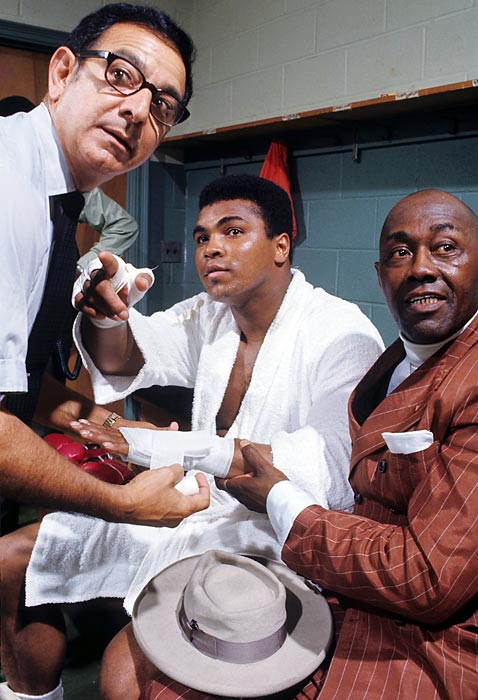 Dundee wraps Ali's hand as comedian Stepin Fetchit looks on before a September 1970 exhibition fight in Atlanta.
