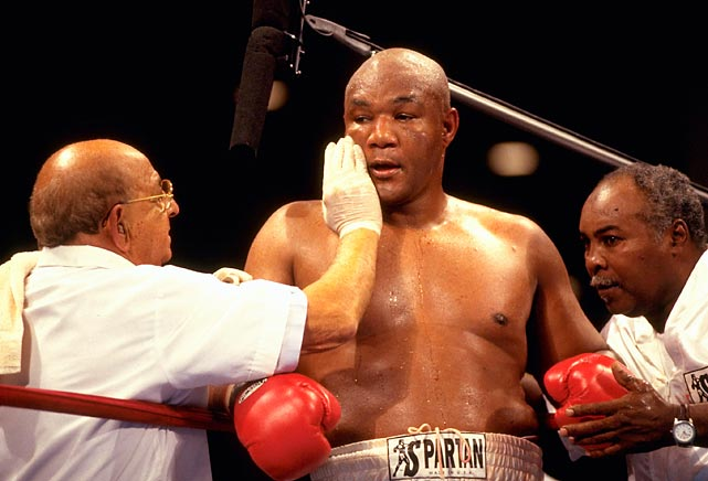 Dundee works on George Foreman during a 1996 fight. Dundee teamed with Foreman in 1994 and helped him become the oldest heavyweight champion in history at age 45.