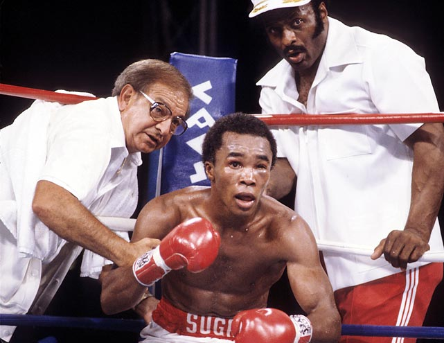 "Dundee talks with Leonard as fellow trainer Janks Morgan looks on in between rounds of Leonard's 1981 title fight against Thomas Hearns. Dundee called Leonard ""a smaller Ali."""