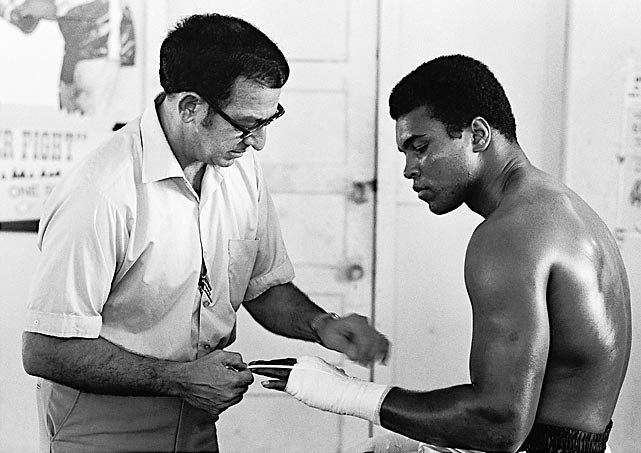 Legendary boxing trainer Angelo Dundee died in his Tampa apartment on Wednesday, Feb. 1. Best known for his work with Muhammad Ali, Dundee trained 15 world champions in all during a career that spanned six decades. He was 90.   Here, Dundee preps Ali at the 5th Street Gym in Miami Beach, Fla., ahead of Ali's October 1970 fight against Jerry Quarry.