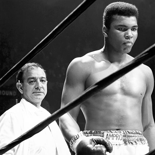 Dundee stands in the ring with Ali during a 1967 title bout against Zora Folley at Madison Square Garden. The fight was Ali's last before he was suspended for refusing to join the military. Dundee stuck with Ali despite his suspension and corresponding fall from grace, training the Champ ahead of his 1970 comeback.