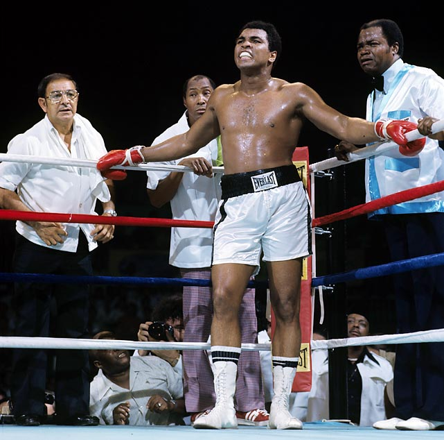 "Dundee stands with (from left) assistant trainer Wali Muhammad, Ali and assistant trainer Bundini Brown during the 1975 ""Thrilla in Manila"" against Joe Frazier. Some have credited Dundee with persuading Ali to continue in the fight, his third against Frazier, when Smokin' Joe was coming on strong in the middle rounds. Ali won when Frazier didn't answer the bell for the 15th round."