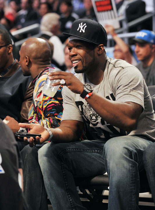 And sitting next to Mayweather was his friend and rapper, 50 Cent.