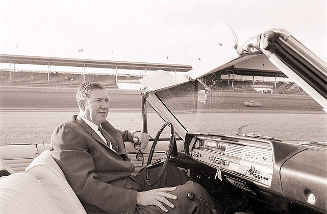 NASCAR founder Bill France Sr. surveys Daytona International Speedway from a car in 1965.
