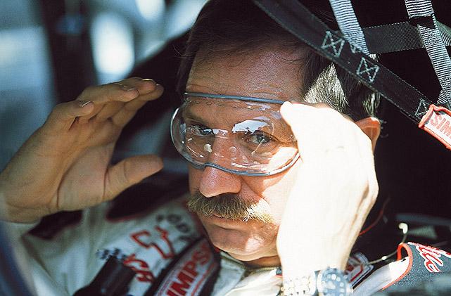 Dale Earnhardt adjusts his goggles car prior to the 2001 Daytona 500. Earnhardt was tragically killed in a crash on the final lap of the 2001 race.
