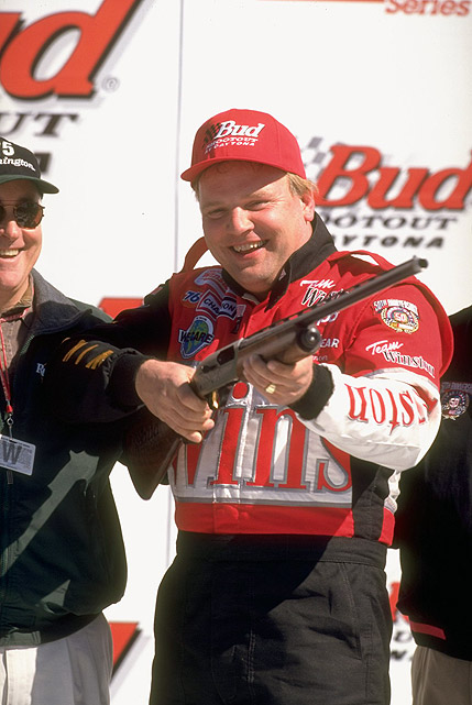 Jimmy Spencer holds a gun before firing up his engine for the start of the 1998 race.