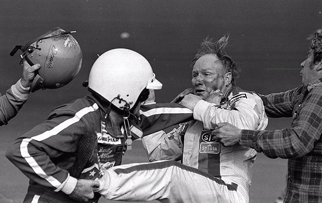 Bobby Allison (left, in helmet) fights with Cale Yarborough (right) as Allison's brother, Donnie, swings his helmet at Yarborough after the 1979 Daytona 500. Donnie Allison was leading the race on the final lap when Yarborough spun both of them into the infield. They started fighting shortly thereafter, prompting Bobby Allison to pull over and join. The incident drew great publicity for NASCAR, with many considering the 1979 500 the most important race in stock car history.