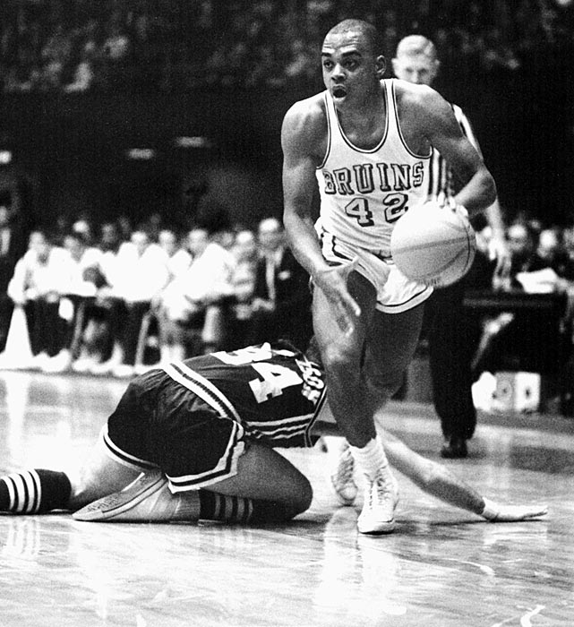 Walt Hazzard dribbles past a Duke player at the 1964 Final Four. Hazzard and guard Gail Goodrich led the Bruins to an undefeated national title campaign in 1964.