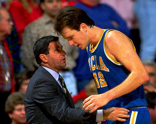 Former UCLA coach Jim Harrick talks with Don MacLean -- the Bruins' all-time leader in total points -- during a 1992 game. Harrick, who led the school to the national title in 1994-95, was fired shortly before the start of the 1996-97 season for lying to university investigators about a recruiting dinner.