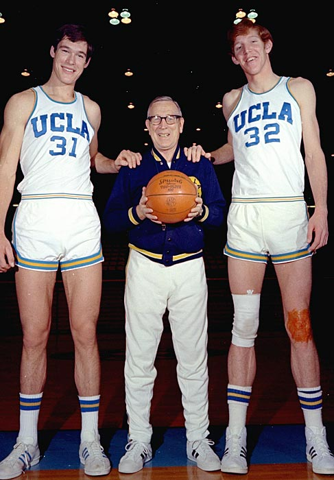 John Wooden is dwarfed by Bill Walton (right) and Swen Nater. Both Nater and Walton were members of some of the UCLA teams that won a record 88 straight games from 1970-1974.