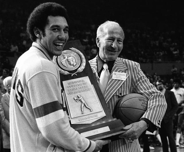 A happy Henry Bibby (left) accepts the 1972 NCAA championship trophy from Tom Scott, chairman of the NCAA tournament committee. The title was UCLA's sixth in a string of seven straight and one of 10 for John Wooden.