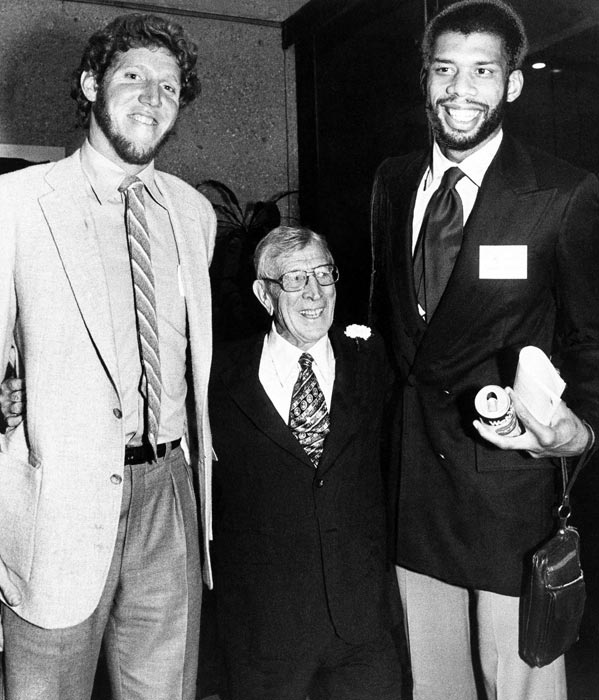 John Wooden is dwarfed by former UCLA basketball stars Bill Walton (left) and Kareem Abdul-Jabbar (right) in this 1980 photo. Abdul-Jabbar -- who went by Lew Alcindor while at UCLA -- is the school's all-time leader in points per game while Walton is the Bruins' all-time leader in rebounds.
