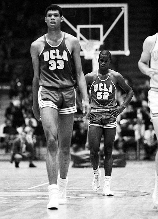 Alcindor (later known as Kareem Abdul Jabbar) walks up the court during the freshman team's 1965 win over the varsity. Alcindor was twice named College Basketball's Player of the Year by the U.S. Basketball Writers' Association.