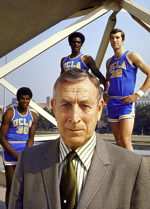 John Wooden poses with players Sidney Wicks, Curtis Rowe and Steve Petterson. Considered by many to be the greatest college basketball coach ever, the Wizard of Westwood won 10 national championships in 28 years at UCLA. He is one three people to be inducted into the Basketball Hall of Fame as both a player and a coach.