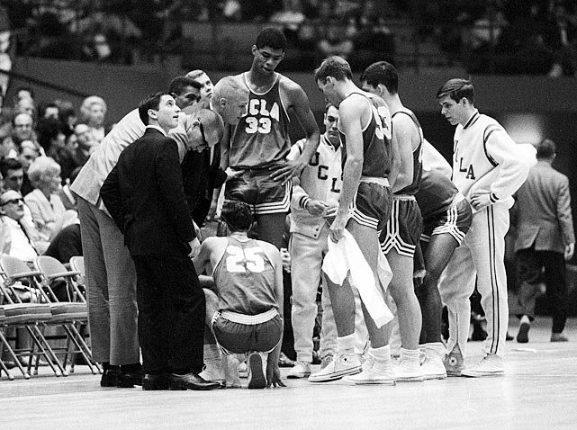 Lew Alcindor (33) huddles with the freshmen team during a 1965 game -- the first ever at the new Pauley Pavilion -- against the UCLA varsity. Alcindor scored 31 points and nabbed 21 rebounds to lead the freshmen to a 75-60 win over the varsity in the game.
