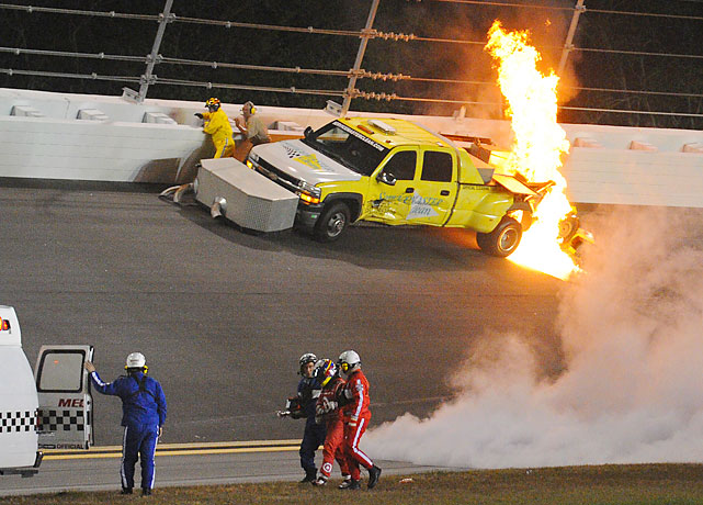 Montoya walks off with emergency personnel as the jet dryer ignites.