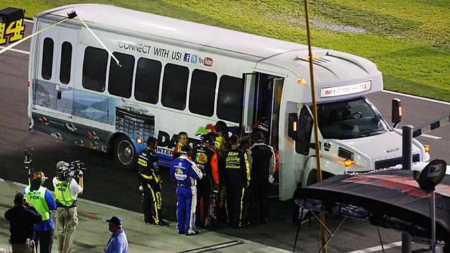One crew member from each team boarded a bus to strap the drivers back into their cars to restart the race after a delay of more than two hours.