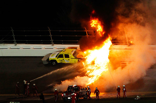 Juan Pablo Montoya's car collided with a jet dryer, igniting Daytona International Speedway on lap 160. Montoya emerged from his car without obvious injuries, but the race was red flagged.