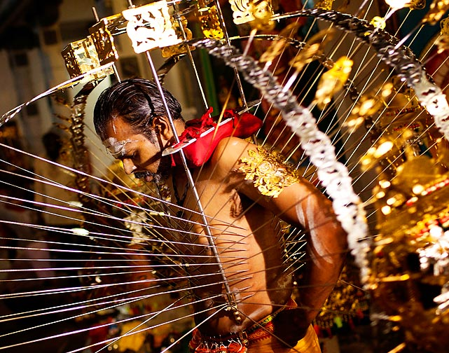 Singapore's Thaipusam is not what one would call a pointless event. It's a Hindu festival celebrated on the full moon in the Tamil month of Thai. Now you know where the base design for the porcupine came from.