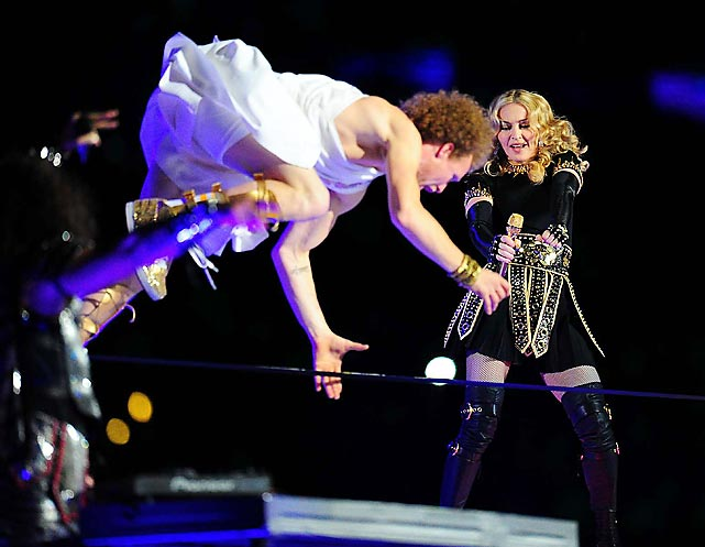"Looking back at one of the highlights of the Super Bowl XLVI Halftime Show: the stirring rendition of the ballet  Swan Lake  featuring Art Garfunkel (left) as ""The Swan."""