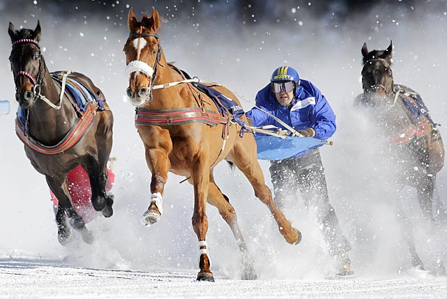 A competitor is pulled by a horse in the Skikjoering Grand Prix race on the frozen Lake of St. Moritz in Switzerland.