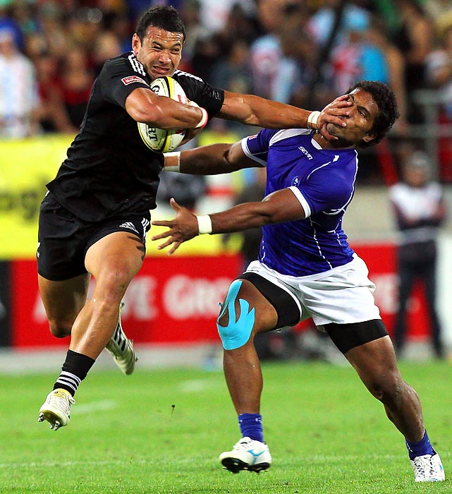 New Zealand's Solomon King stiff arms Samoan Faatonina Autagavaia during pool play at the Rugby Sevens tournament in Wellington.