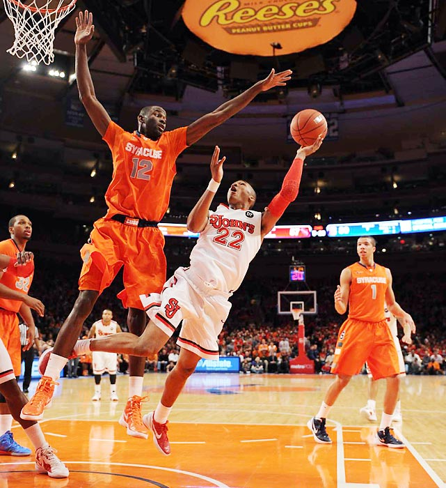 St. Johns' Amir Garrett attempts a layup against Syracuse big man Baye Moussa Keita.