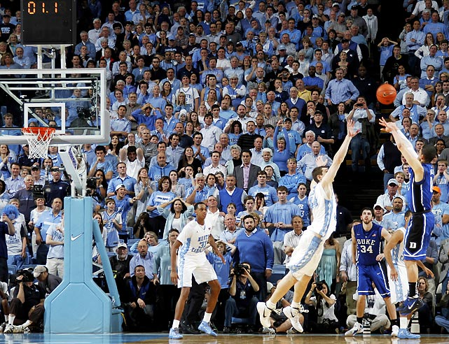 Duke freshman Austin Rivers shoots the game-winning three-pointer over North Carolina forward Tyler Zeller in the Blue Devils' 85-84 win at the Tar Heels. Rivers' three completed Duke's late comeback from a 10-point deficit.