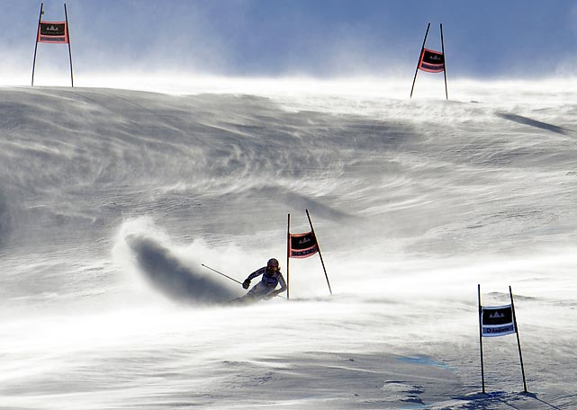 French skier Marion Bertrand fights gusting winds as she speeds down the course during a World Cup Giant Slalom event in Andorra.