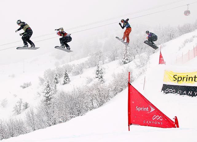Nate Holland (left) leads a semifinal heat of the U.S. Grand Prix Snowboardcross Finals in Park City, Utah.