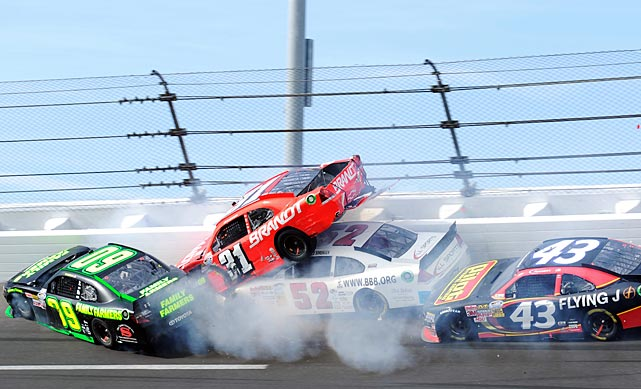 Kenny Wallace's No. 09 car spins into Justin Allgaier, whose No. 31 car is lifted into the air by Reed Sorenson's No. 52 during the NASCAR Nationwide Series DRIVE4COPD 300 at Daytona International Speedway on Saturday.