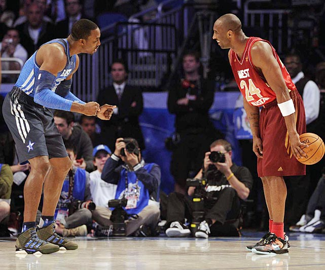Dwight Howard (left) shares some light hearted banter with Kobe Bryant on the court at Sunday's All Star game.