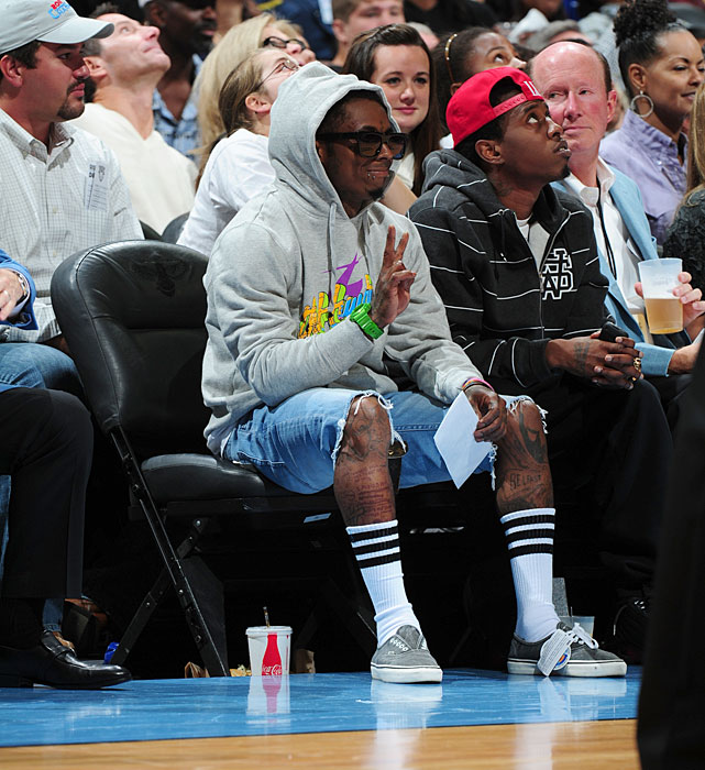 Lil Wayne takes in Game 3 of the 2011 WNBA Finals between the Minnesota Lynx and Atlanta Dream.