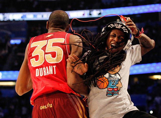 Whether it's attending a NBA game, partying with athletes or wearing the hat of every single sports team on Planet Earth, Lil Wayne has become synonymous with the world of athletics. In this photo, Kevin Durant and Wayne greet each other during the 2012 NBA All-Star game. Durant would go onto win MVP honors after the West's three-point victory.