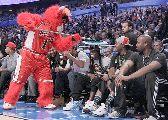 Chicago mascot Benny the Bull wipes Weezy's head during the 2012 All-Star game in Orlando.